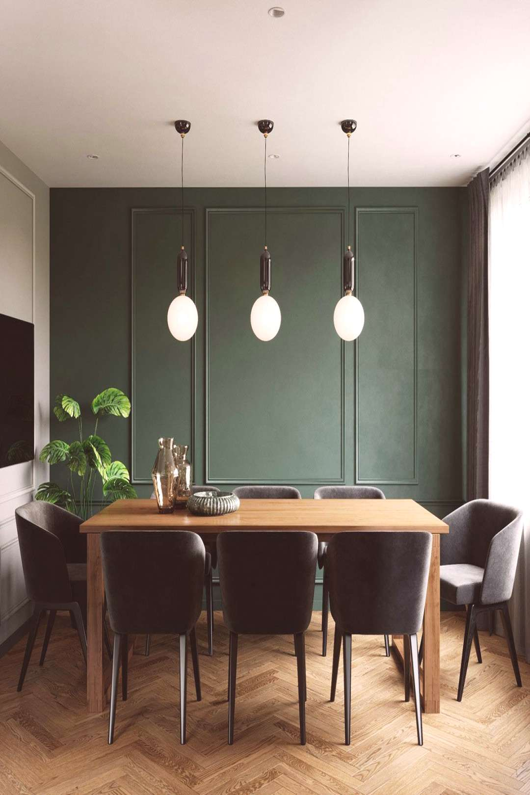 Beautiful dining room pendant lights by Jaime Hayon hang in a row above the table. Not only do thes