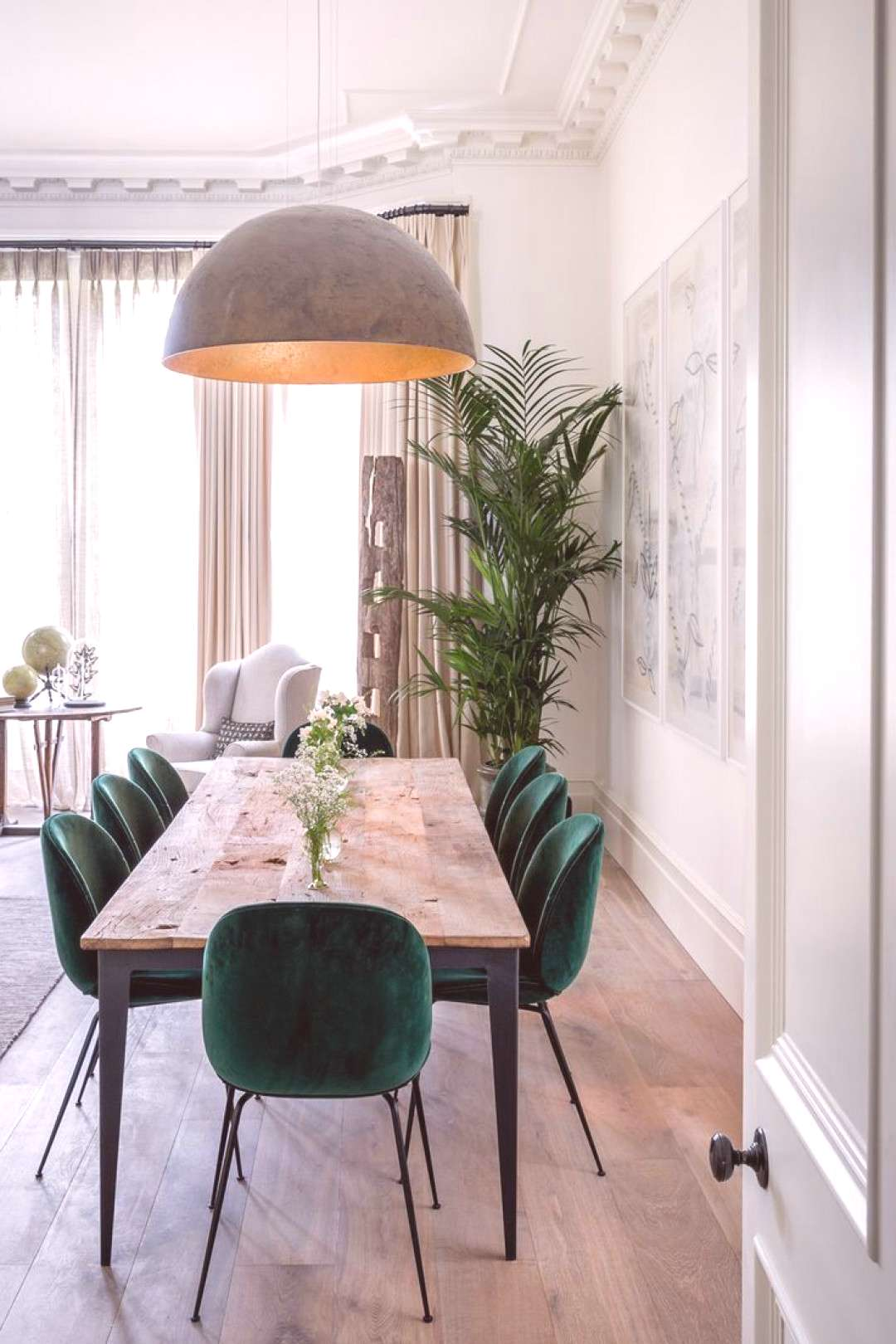 green velvet chairs for a modern minimal dining area