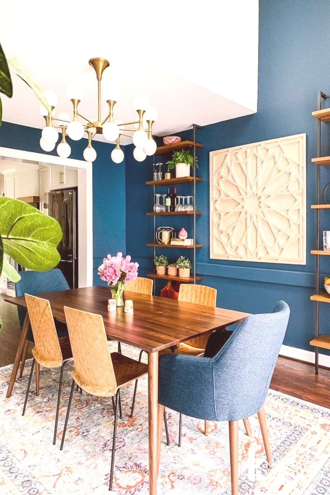 The new mid-century modern furniture for our eclectic, navy blue dining room arrived and its PERFE